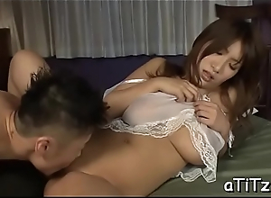 Enticing oriental with lovely boobs entices with wet blowbang