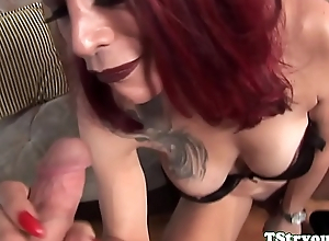 Redhead ts beauty sucking dong at one's fingertips casting